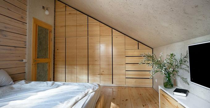 不仅要考虑到阁楼原有的结构和灯光的设置,还要注意合理利用阁楼空间.图片